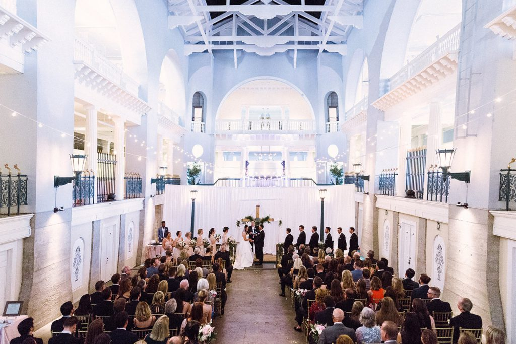 A wedding ceremony in a church that represents the Z Event Company's feature in the Lightner Museum, as well as their catering services