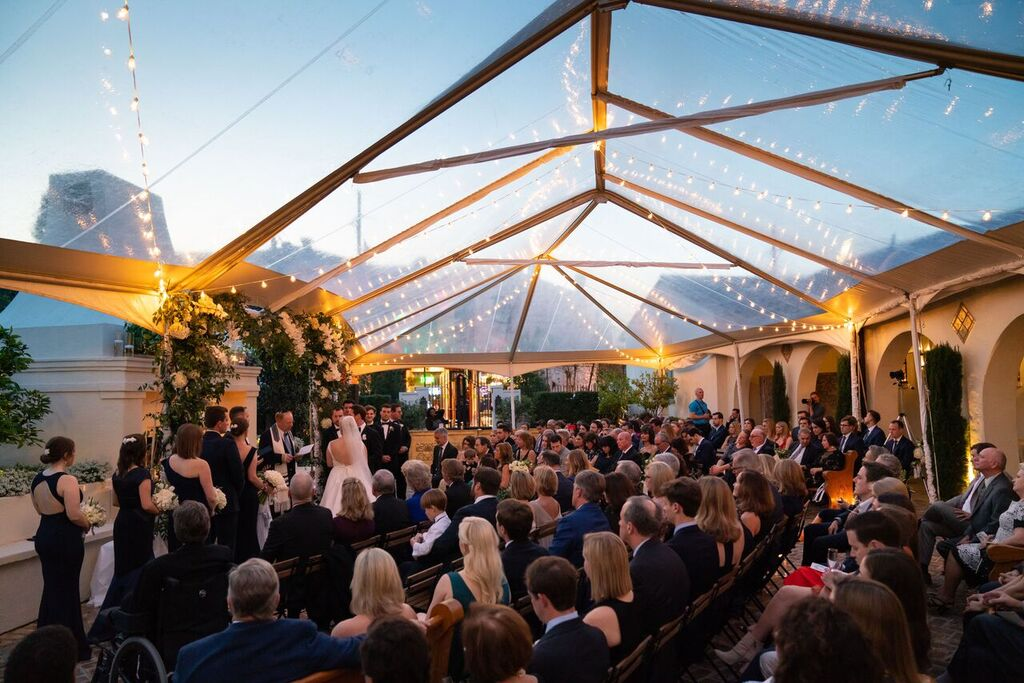 People gathered under a clear roof for a wedding